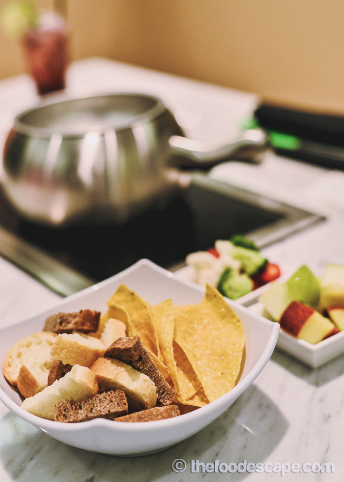 Each cheese fondue comes with artisan breads and seasonal vegetables ...